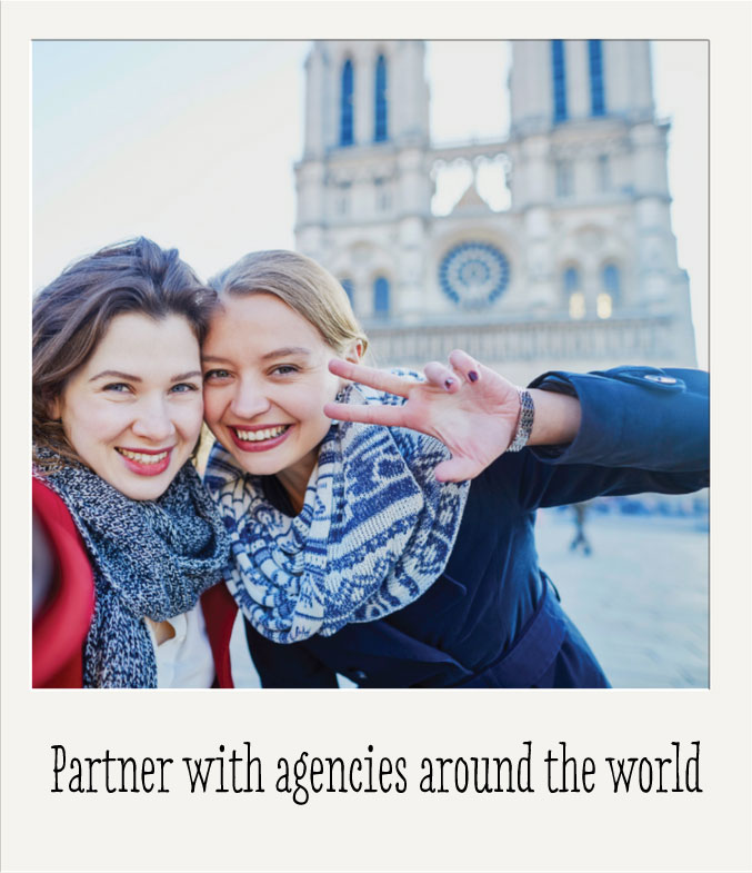 Photo of an au pair with a new friend in Paris, France in front of Notre Dame cathedral